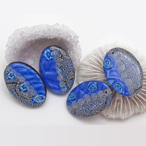 Bright blue metallic clay and translucent lace canes