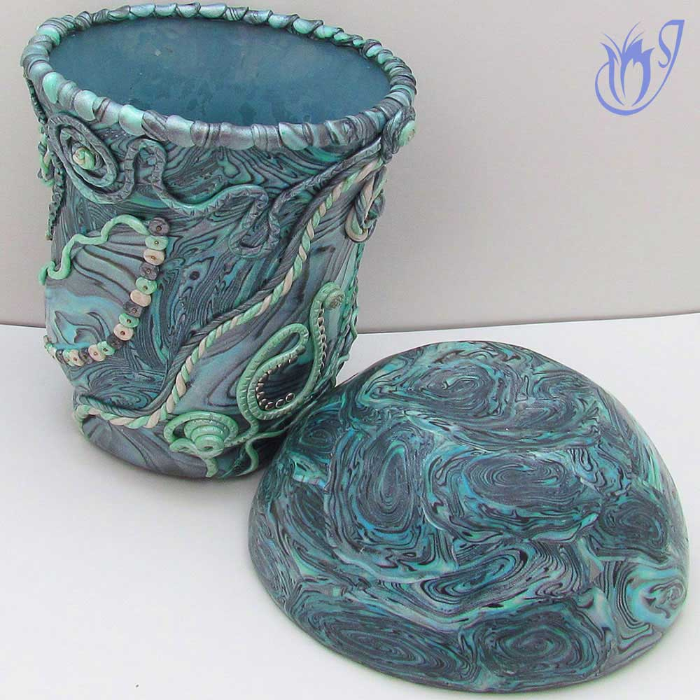 Polymer clay covered jar and bowl