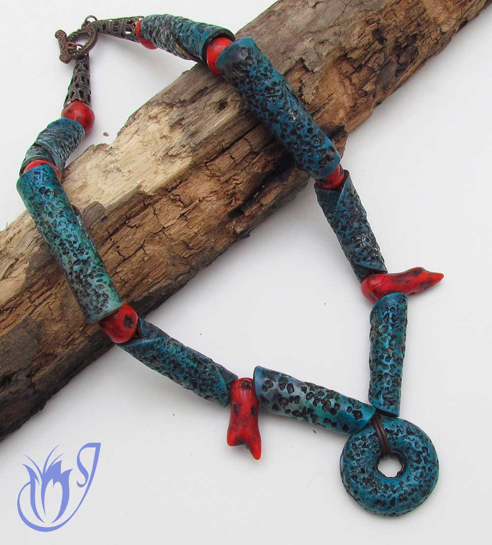 Faux coral and salt-eaten polymer clay necklace