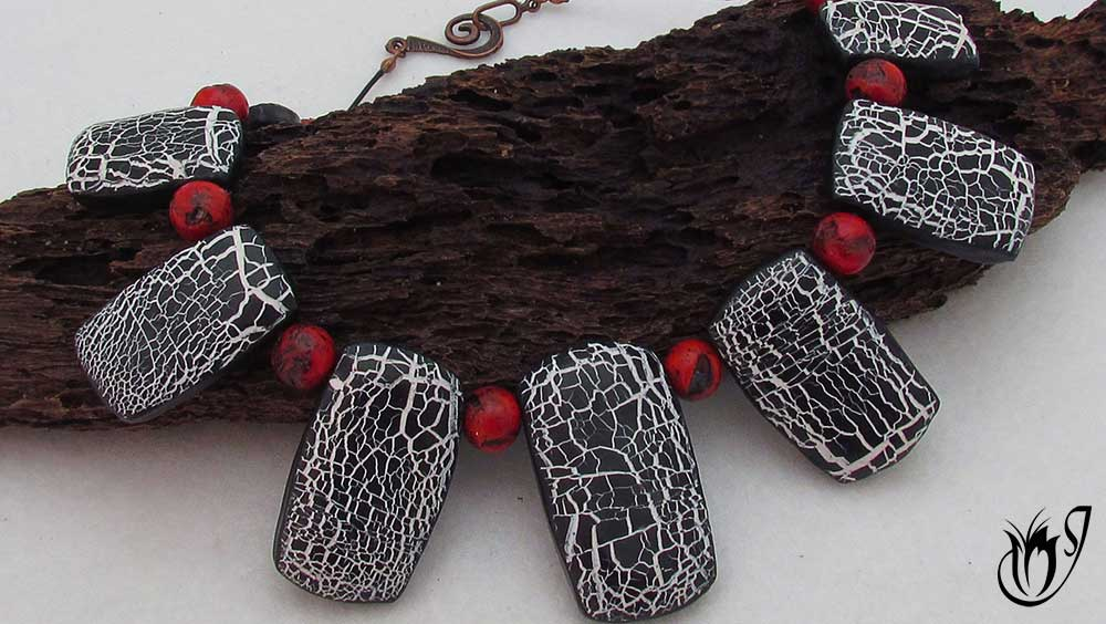 Crackled black and white polymer clay beads combined with faux red coral