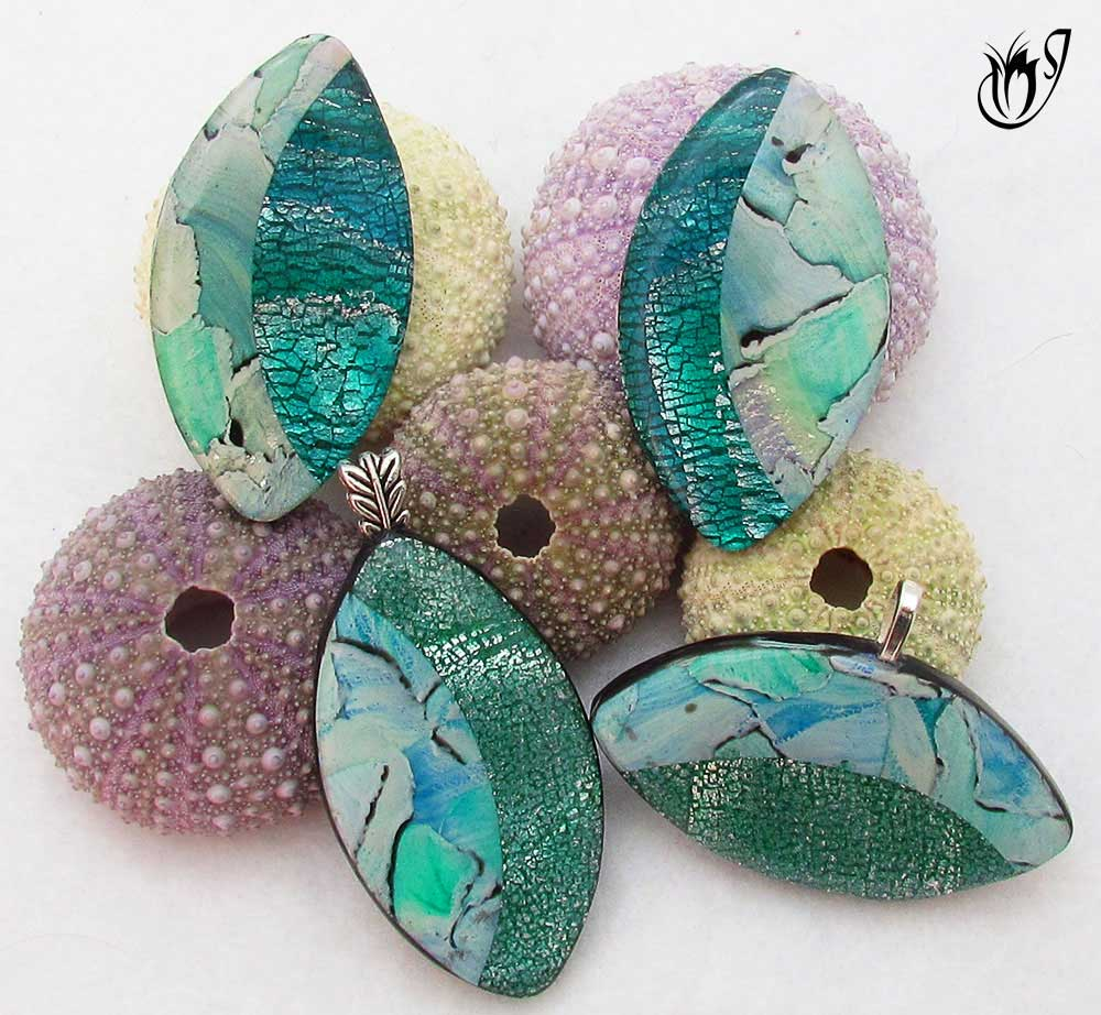 Silver leaf mokume gane and watercolor polymer clay beads