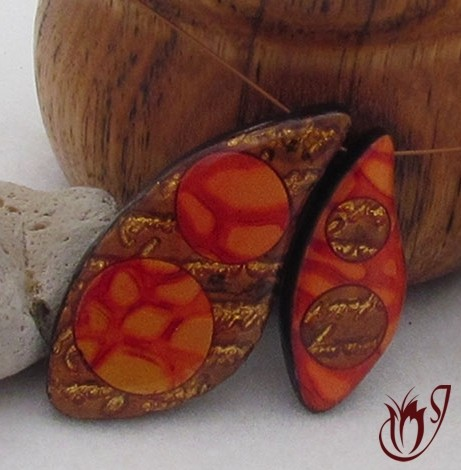 Mixed media and mica shift polymer clay beads.