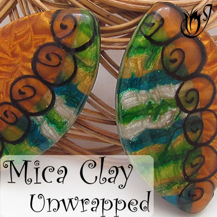 Polymer clay mica shift and translucent nautilus cane beads