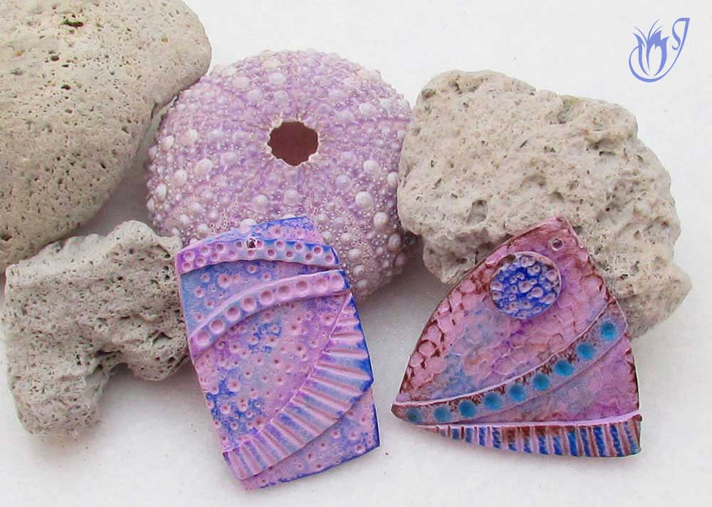 Textured polymer clay beads with pastels